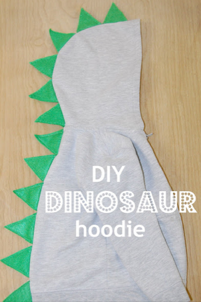 Here a simple sweatshirt is turned into a cute dinosaur costume.