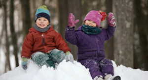 outdoor gear recommendations for kids - 2 kids in snow in gear