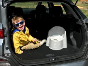 kid with potty in back of car - must-have products for active toddlers