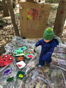 outdoor sensory play ideas - playing with paint
