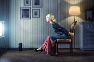 Woman watching true crime tv show