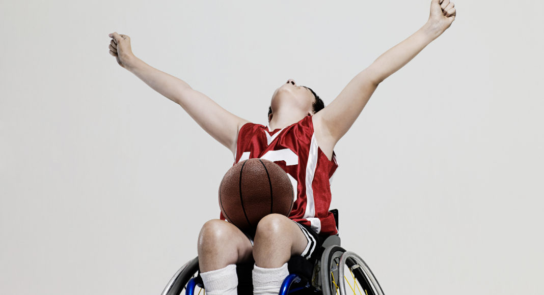 kid playing wheelchair basketball - ways to support the differently abled community on the Seacoast