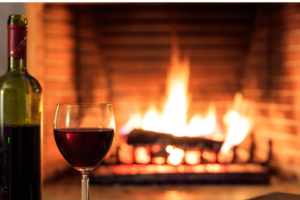 Restaurants with a fireplace on the Seacoast - wine and glass in front of fire