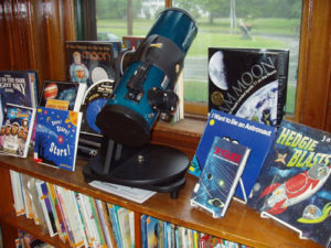 telescope and books - astronomy and kids