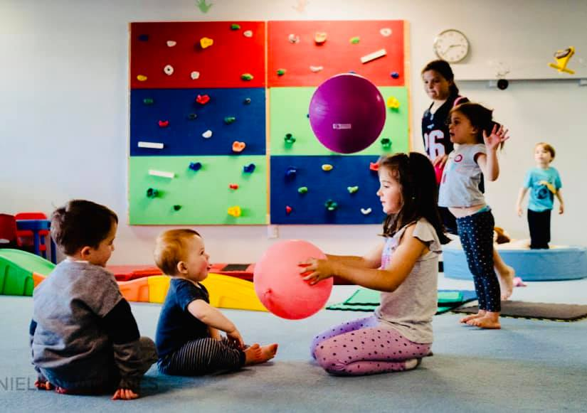 Beam Fitness and Tutoring Seacoast Indoor Place Place Kids playing with ball