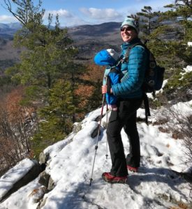 white mountain hiking in winter with baby