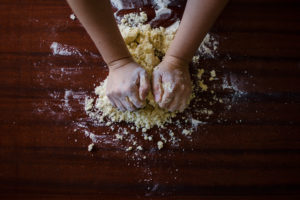 Canva - Hands Kneading Dough