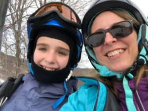 learn to ski on the seacoast - daughter and mother on ski lift
