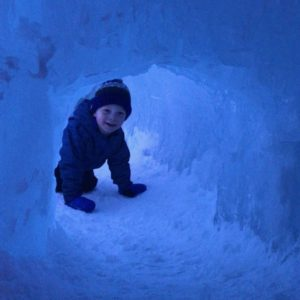 boy in an ice tunnel - family friendly events on the Seacoast in the winter