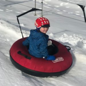 winter activities on the Seacoast - kid in a snow tube