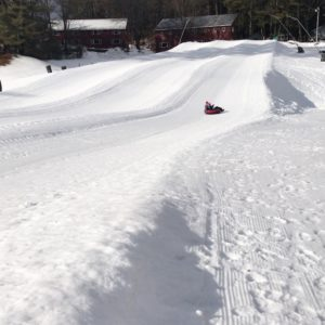 Seacoast winter fun for kids - child snowtubing an hour away from the Seacoast