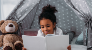 girl reading - fun reading and writing activities for kids