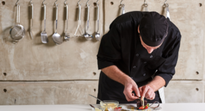 chef preparing food in a kitchen - Seacoast restaurants
