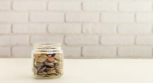 jar of coins - saving money with Seacoast family memberships