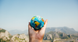 Best VIrtual Field Trips - hand holding a small globe