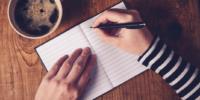Captain's log USS Coronavirus: woman writing in journal with coffee cup