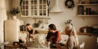 family-sits-on-table-inside-kitchen-3171153