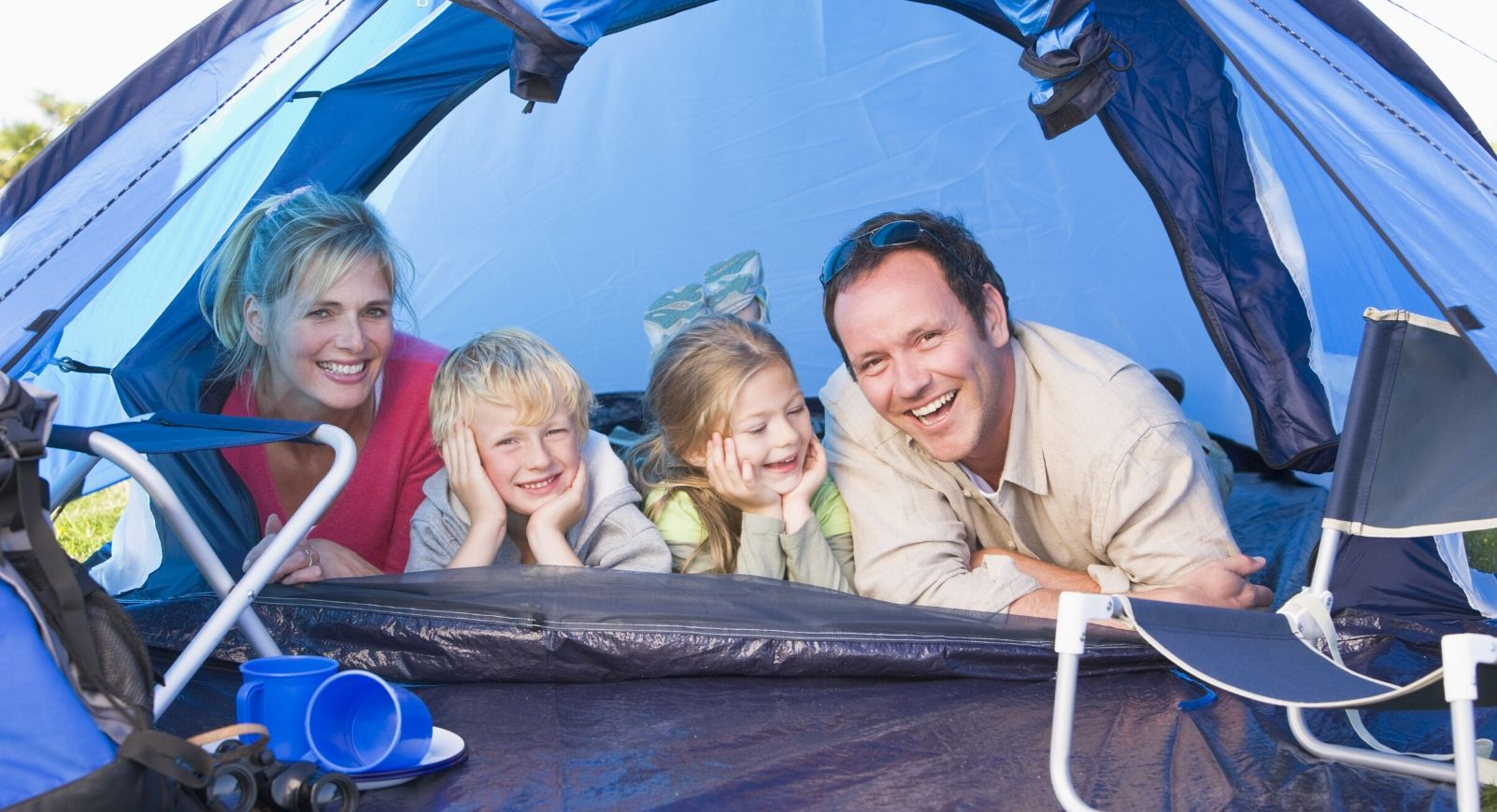 Family in blue tent