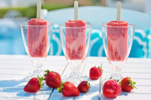 Canva - Sweet Strawberry Popsicles in Glasses