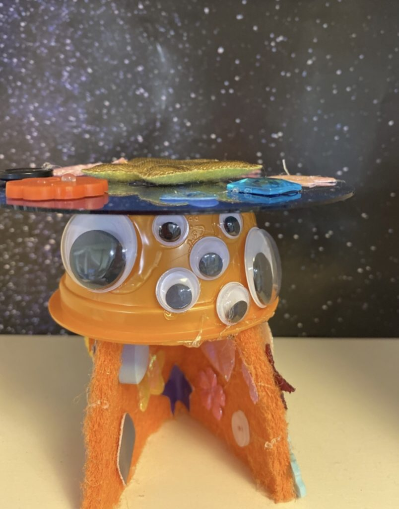 imaginative play ideas for preschoolers - rocket ship from a yogurt cup