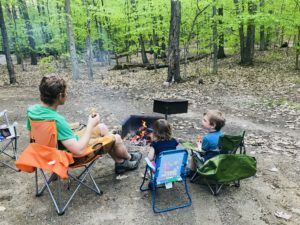 Dad and kids at campfire