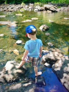 walking on stones in river