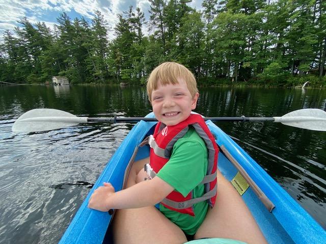 kid in kayak