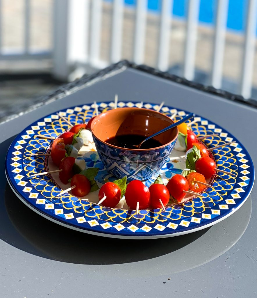 Caprese Salad on a platter - must haves for outdoor entertaining
