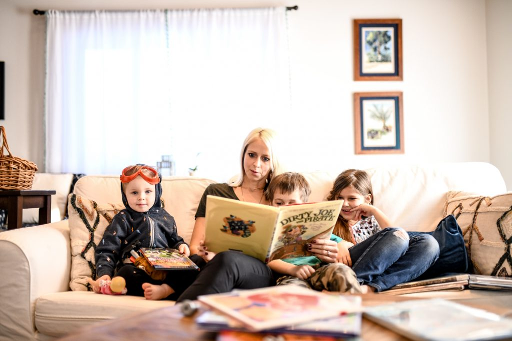 mother reading to three children -- homeschooling in new hampshire