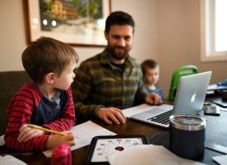 father at table with computer and two young sons - local resources for homeschooling in New Hampshire