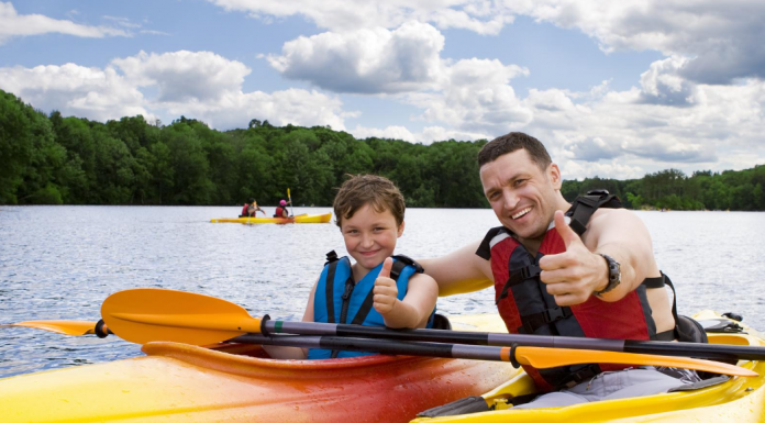 Father and Son give thumbs up on kayaks