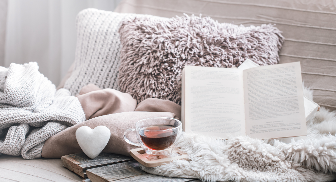 cozy pillow, tea and book set up. Winter hygge favorites.