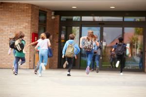 Kids running into school - guns and NH schools