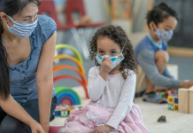 Does wearing a mask hinder a child's language development? child and caregiver in a mask