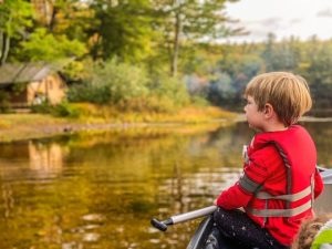 small child in canoe with life vest - where to get outside with kids on the Seacoast