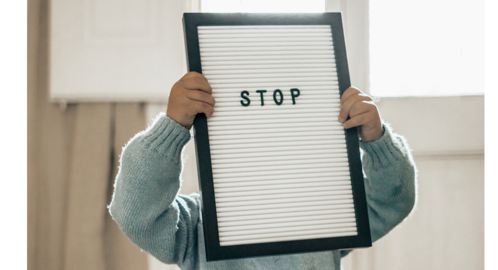 """Body Safety Habits for toddlers -- child with a sign that says """"stop"""""""