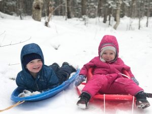 kids on sleds