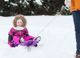 mom pulls kids in sled