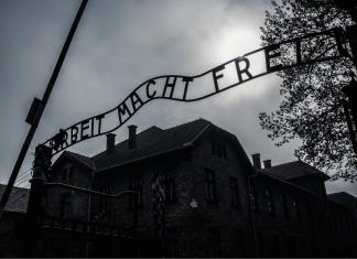 albeit macht frei sign at Aushwitz - International Holocaust Remembrance Day