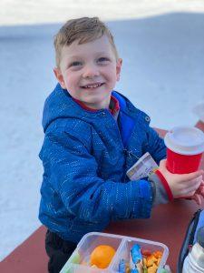 happy child at ski slope