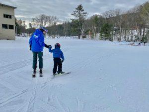 child and ski instructor