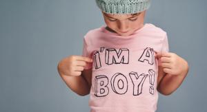 boy in pink shirt that says im a boy