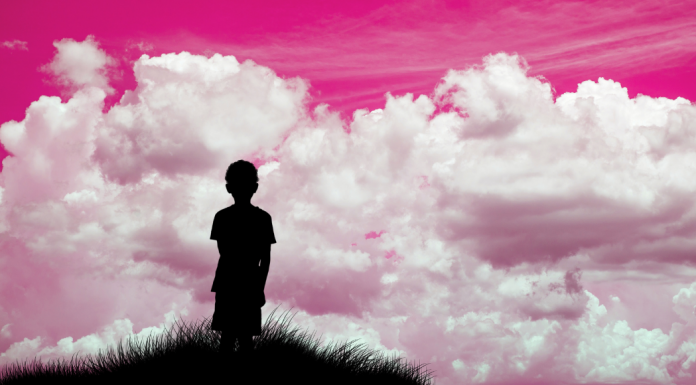 boy with pink background future is female