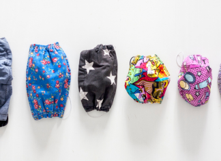 lineup of masks from big to small -- preparing kids to go out during a pandemic