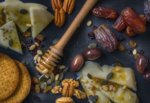 Spread of food, crackers, cheese, sesame, nuts, honey, figs. Common food allergy myths. Image from Dana Tentis/Pexels