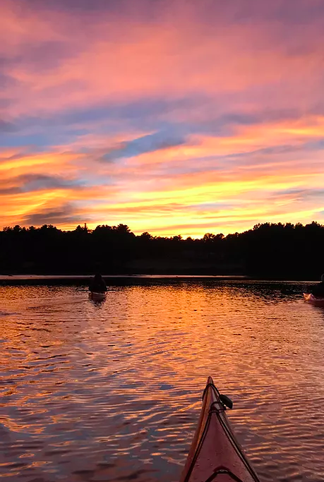 unique mother's Day gifts - a paddling tour of the Seacoast, pic of a sunset over water
