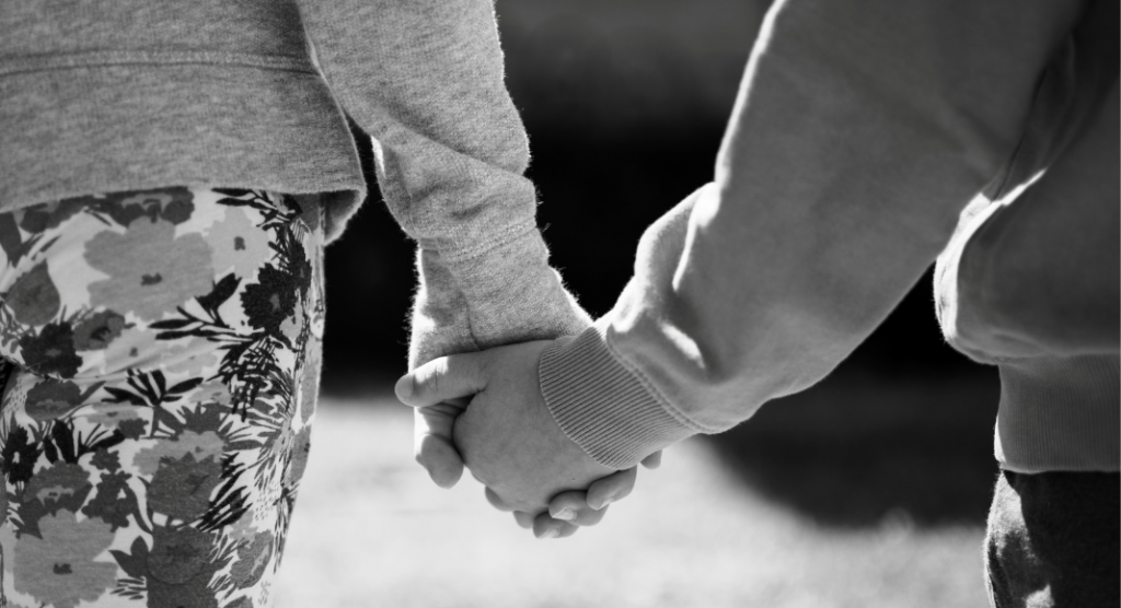 black and white photo of two people holding hands, just hands are visible - mother's day lessons