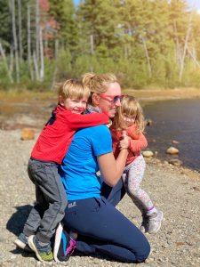 kids hug mom on hike