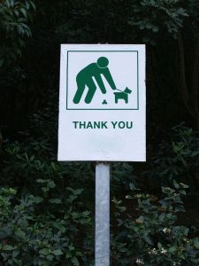 Sign to pick up after dog