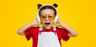 child listening to a podcast